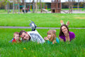 Young happy family having fun in the grass Royalty Free Stock Images