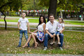 Young happy family portrait on background of the autumn park Royalty Free Stock Photo