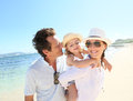 Young happy family taking pleasure on the seaside portrait of beach Stock Photo