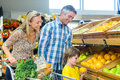 Young happy family with their son at supermarket Royalty Free Stock Photography