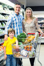 Young happy family with their son at supermarket Royalty Free Stock Photo