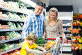 Young happy family with their son at supermarket Royalty Free Stock Photos