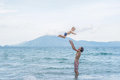 Young happy father holding up in his arms little son putting him Royalty Free Stock Photo