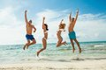 Young happy friends havin fun on the beach summer holidays lifestyle Stock Photography