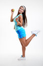 Young happy girl with apple and jump rope on white training background Stock Photos