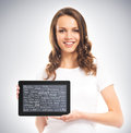 A young and happy girl holding a tablet computer Royalty Free Stock Photo