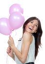 Young happy girl with pink balloons Royalty Free Stock Images