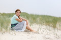 Young happy girl relaxing on sand dunes of the beach of st peter ording north sea germany Royalty Free Stock Images