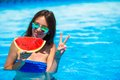 Young happy girl in sunglasses with watermelon Royalty Free Stock Photo
