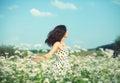 Girl walking on the buckwheat field Royalty Free Stock Photo