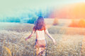 Young girl walking on the flower field Royalty Free Stock Photo