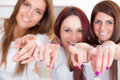 Young happy girls pointing their fingers at you beautiful with focus on Royalty Free Stock Images