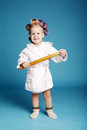 Young happy housewife with rolling pin on blue background Royalty Free Stock Photos