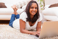 Young happy indian woman using a laptop Royalty Free Stock Image