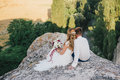 Young happy just married couple posing on the top of the mountain Royalty Free Stock Photo
