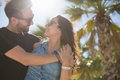 Young happy lovers cuddling together in sun light Royalty Free Stock Photo