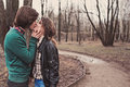 Young happy loving couple kissing on the walk in early spring day Royalty Free Stock Images