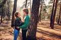 Young happy loving couple on the walk looking at each other in forest Royalty Free Stock Image
