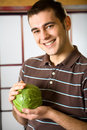 Young happy man with cabbage Stock Photos