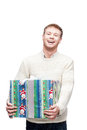Young happy man holding big heavy gift Stock Images