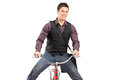 Young happy man riding a bike isolated on white background Stock Photography