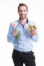 Young happy man with a rose and a gift. Stock Photos