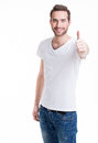 Young happy man with thumbs up sign in casuals isolated on white background Stock Photo