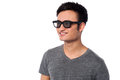 Young happy man wearing dark sunglasses smiling boy shades and looking away Royalty Free Stock Photo
