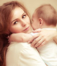 Young happy mother with baby photo for a design Royalty Free Stock Photo
