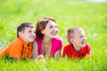 Young happy mother with children in park outdoor portrait Royalty Free Stock Images