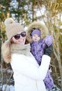 Young happy mother walking with her little daughter Royalty Free Stock Photo
