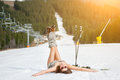 Young happy naked skier is having fun on snowy slope near ski lift at ski resort Royalty Free Stock Photo