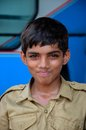 Young happy pakistani boy scout lahore pakistan september a in uniform shyly looks at camera his troop were assisting the Royalty Free Stock Photography