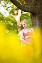 Young happy pregnant woman relaxing in nature and enjoying life Royalty Free Stock Photography