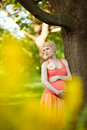 Young happy pregnant woman relaxing in nature and enjoying life Royalty Free Stock Photos