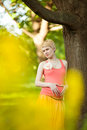Young happy pregnant woman relaxing in nature and enjoying life Royalty Free Stock Photo