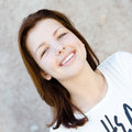 Young happy smiling beautiful woman portrait looking at camera teenage girl head shot Stock Photo
