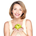 Young happy smiling woman with green apple isolated on white Royalty Free Stock Photo