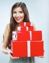 Young happy smiling woman hold red gift box isolated studio background female model Royalty Free Stock Image