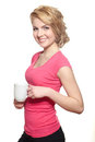 Young happy smiling woman holding white cup of coffe Stock Photo