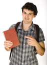 Young happy student carrying bag and books isolated Royalty Free Stock Photography