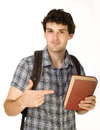 Young happy student carrying bag and books isolated Royalty Free Stock Images