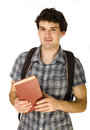 Young happy student carrying bag and books isolated Stock Photography