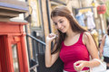 Young happy teenage girl in urban place a Royalty Free Stock Photo