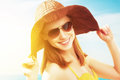 Royalty Free Stock Photography Young happy woman on the beach in  sunglasses and a hat