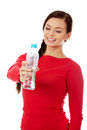 Young happy woman with bottle of mineral water Royalty Free Stock Photo