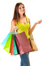 Young happy woman with colorful paper shopping bags isolated on white Stock Photography