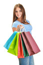 Young happy woman with colorful paper shopping bags isolated on white Royalty Free Stock Photo