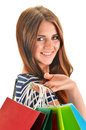 Young happy woman with colorful paper shopping bags isolated on white Stock Photos