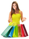 Young happy woman with colorful paper shopping bags on white Stock Photo